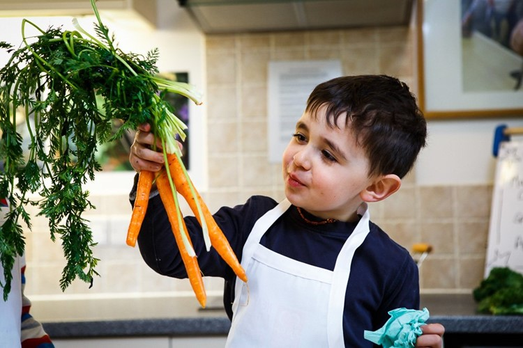 Child with carrots